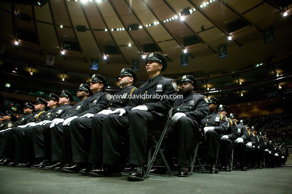 29 December 2005 - New York City, NY - Recruits belonging to the New York Police Department's Class of 2005 attend their graduation ceremony, 29 December 2005, in New York City. 1,735 recruits were sworn in during the ceremony.