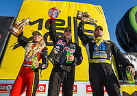 Feb 12, 2017; Pomona, CA, USA; (From left) NHRA top fuel driver Leah Pritchett , pro stock driver Jason Line and funny car driver Matt Hagan celebrate after winning the Winternationals at Auto Club Raceway at Pomona. Mandatory Credit: Mark J. Rebilas-USA TODAY Sports