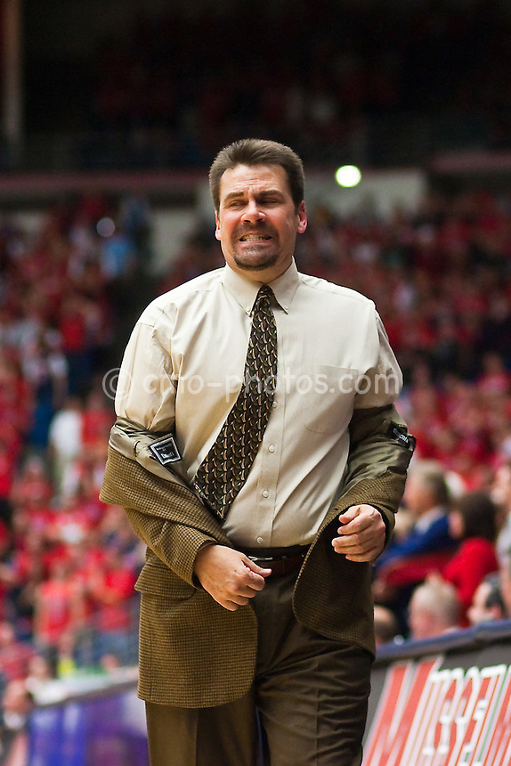 Feb 12, 2009; Tucson, AZ, USA; Arizona Wildcats interim head coach Russ Pennell reacts to an official's call in the second half of a game against the USC Trojans at the McKale Center.  The Wildcats won the game 83-76.