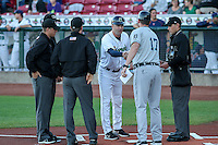 West Michigan Whitecaps manager Andrew Graham (17) and Cedar Rapids Kernels manager Jake Mauer (12) exchange lineup cards prior to game five of the Midwest League Championship Series with umpires Brock Ballou (far right), Richard Genera, Tyler Olson, and Chris Marco (L-R) on September 21st, 2015 at Perfect Game Field at Veterans Memorial Stadium in Cedar Rapids, Iowa.  West Michigan defeated Cedar Rapids 3-2 to win the Midwest League Championship.  (Brad Krause/Four Seam Images)