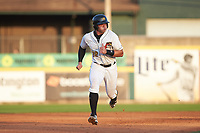 Deon Stafford (22) of the West Virginia Power hustles towards third base against the Lexington Legends at Appalachian Power Park on June 7, 2018 in Charleston, West Virginia. The Power defeated the Legends 5-1. (Brian Westerholt/Four Seam Images)