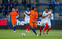 Juninho Bacuna (FC Groningen) of Netherlands & Chris Willock (Benfica) of England U20 during the International friendly match between England U20 and Netherlands U20 at New Bucks Head, Telford, England on 31 August 2017. Photo by Andy Rowland.