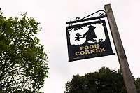 Sign for Pooh Corner, a shop and teashop dedicated to the A.A. Milne Winnie the Pooh stories. Ashdown Forest, Sussex, UK, May 20, 2017. Picturesque Ashdown Forest stretches across the countries of Surrey, Sussex and Kent, and is the largest open access space in the South East of England. It is famous as the geographical inspiration for the Winnie the Pooh stories and is popular with fans of the characters.
