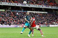 (L-R) Andre Ayew of Swansea City challenged by Bambo Diaby of Barnsley during the Sky Bet Championship match between Barnsley and Swansea City at Oakwell Stadium, Barnsley, England, UK. Saturday 19 October 2019