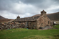 Old stone walls of Burnmouth Bothy, Rackwick Bay, Hoy, Orkney, Scotland