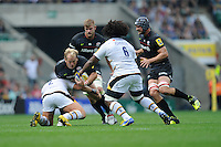 Petrus du Plessis of Saracens is tackled by Carlo Festuccia of Wasps during the Premiership Rugby Round 1 match between Saracens and Wasps at Twickenham Stadium on Saturday 6th September 2014 (Photo by Rob Munro)