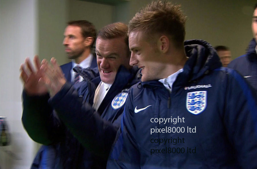 Pic shows:<br /> Slovenia v England<br /> Dropped captain Wayne Rooney in the tunnel made a circle with his fingers almost like he wanted to strangle someone - Manager Gareth Southgate did not seem as amused as  Jamie Vardy.<br /> <br /> <br /> <br /> Picture by Pixel8000 07917221968