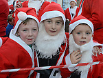 Mark Askins, Cian Cleary and Conor McQuillan who took part in the Drogheda Santa Run to Scotch Hall. Photo:Colin Bell/pressphotos.ie