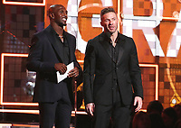 Devin McCourty, left, and Julian Edelman present the award for best pop duo or group performance at the 61st annual Grammy Awards on Sunday, Feb. 10, 2019, in Los Angeles. (Photo by Matt Sayles/Invision/AP)