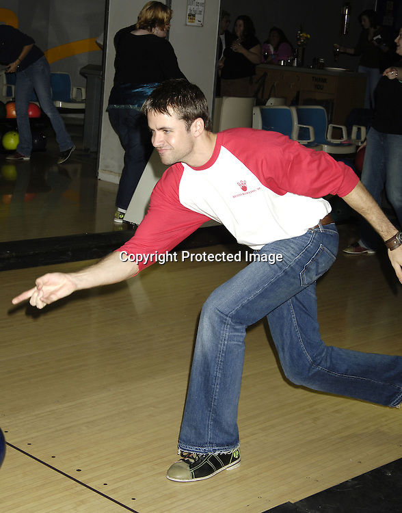 John Driscoll ..at The Guiding Light Bowling event hosted by Liz Keifer and Jerry verDorn at the Port Authority Bowling Ally on October 15, 2005. ..Photo by Robin Platzer, Twin Images