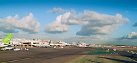 Airlines, Taxing on Runway, Clouds, Plane Parked at Gate