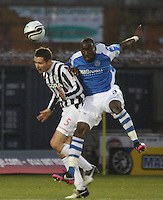 Lee Mair (left) and Greg Tade challenge in the air in the St Mirren v St Johnstone Clydesdale Bank Scottish Premier League match played at St Mirren Park, Paisley on 8.12.12.
