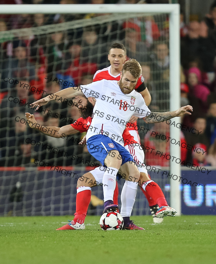 (copyright &amp; photo: STARSPORT)<br /> 12.11.16 - Wales v Serbia, FIFA World Cup Qualifier 2018 - Aleksandar Katai of Serbia is challenged by Joe Ledley of Wales