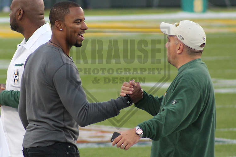 GREEN BAY - SEPTEMBER 2011:  Former Green Bay Packers safety Darren Sharper talks with a member of the Packers prior to a game on September 8, 2011 at Lambeau Field in Green Bay, Wisconsin. (Photo by Brad Krause) ...