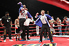 Spencer Fearon jumps for joy as his fighter Darren Hamilton becomes the new British Light welterweight champion