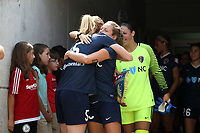 Cary, North Carolina  - Sunday May 21, 2017: Samantha Mewis and Kristen Hamilton embrace prior to a regular season National Women's Soccer League (NWSL) match between the North Carolina Courage and the Chicago Red Stars at Sahlen's Stadium at WakeMed Soccer Park. Chicago won the game 3-1.