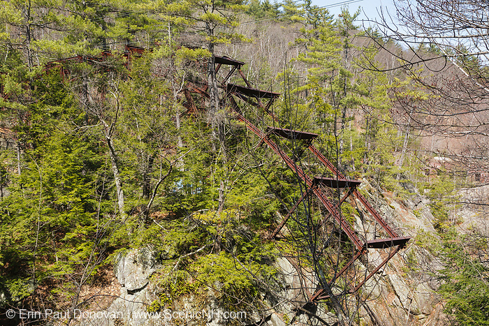"Remnants of the ""Pumpkin Seed Bridge"" at Livermore Falls in Campton, New Hampshire. This bridge was erected in 1886 by the Berlin Iron Bridge Company and crossed the Pemigewasset River. It is 263 feet long and closed in 1959."