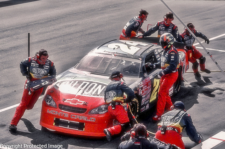 NASCAR driver Jeff Gordon recieves service on his #24 Chevrolet Monte Carlo during a pit stop in the Mall.Com 400 at Darlington Raceway in Darlington, SC Sunday, March 19, 2000.(Photo by Brian Cleary)
