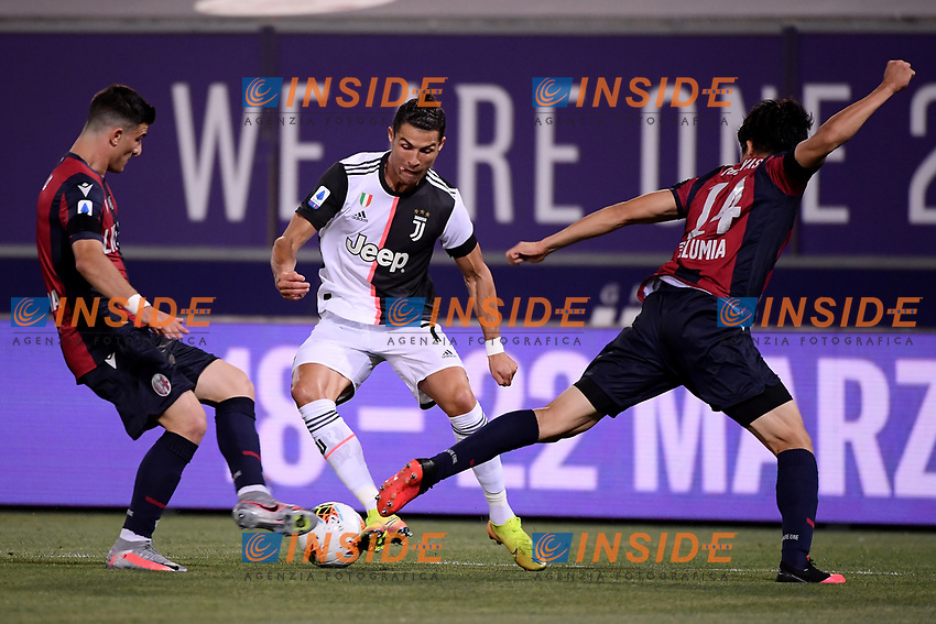 Riccardo Orsolini of Bologna FC , Cristiano Ronaldo of Juventus , Takehiro Tomiyasu of Bologna FC compete for the ball during the Serie A football match between Bologna FC and Juventus at Dall'Ara stadium in Bologna ( Italy ), June 22th, 2020. Play resumes behind closed doors following the outbreak of the coronavirus disease. <br /> Photo Federico Tardito / Insidefoto