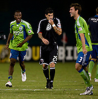 Santino Quaranta, Steve Zakuani, Brad Evans. The Seattle Sounders defeated DC United, 2-1, to win the 2009 Lamr Hunt U.S. Open Cup at RFK Stadium in Washington, DC.