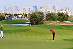30 August 2009: Tiger Woods putts on the 9th hole green during the final round of The Barclays PGA Playoffs at Liberty National Golf Course in Jersey City, New Jersey.
