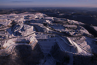 White snow defines the contours of a mountaintop removal site. The v shapes are valley fills.