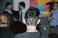 """Genevieve Coursey, a campaign volunteer from South Windsor, Conn., is seen with """"Pete 2020"""" shaved into the back of her hair, after Democratic presidential candidate Pete Buttigieg spoke at a campaign event at the Currier Museum of Art in Manchester, New Hampshire, USA, on Fri., Apr. 5, 2019. The venue was filled to capacity about an hour before the candidate's arrival, so Buttigieg delivered an impromptu speech to those denied entry outside the museum before the official event. Buttigieg is the mayor of South Bend, Indiana, and was widely considered a long-shot candidate until his appearance in a CNN town hall in March 2019 which catapulted his campaign to prominence and substantial donations. <br /> <br /> Coursey says of the haircut, """"It was a crazy idea...Luckily it's a short name."""" She had a Sam Flynt of the West Main Barbershop in Vernon, Conn., shave the design the day before. Coursey says she started supporting Buttigieg about a month and a half earlier. """"""""He's such a different candidate. I kind of fell for him. I wanted to vote for a woman. I'm all in for Pete!"""""""