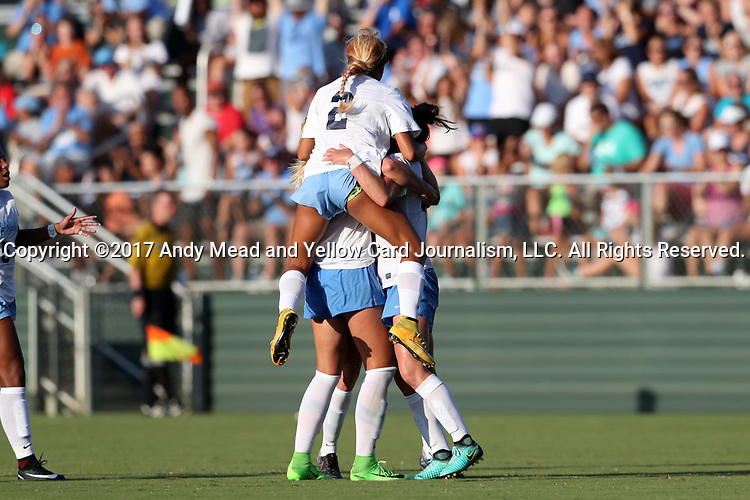 CARY, NC - AUGUST 18: North Carolina's Joanna Boyles is mobbed by teammates after scoring a goal. The University of North Carolina Tar Heels hosted the Duke University Blue Devils on August 18, 2017, at Koka Booth Stadium in Cary, NC in a Division I college soccer game.