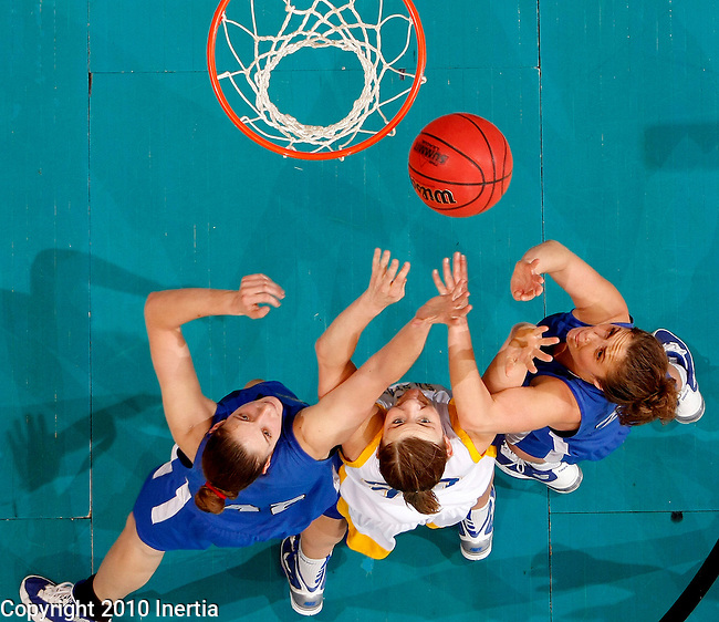 SIOUX FALLS, SD - MARCH 7:   Eva Ivanova #42 and Jordan Zuppe #23 of IPFW battle for a rebound with Ashley Eide #30 of SDSU in the second half of their quarterfinal game at the 2010 Summit League Championship Sunday afternoon at the Sunday afternoon at the Sioux Falls Arena in Sioux Falls, SD.  (Photo by Dave Eggen/Inertia)