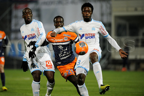 29.11.2013. Marseilles, France. French League 1 football. Marseilles versus Montpellier.  Montano Caicedo (MHSC) - Nkoulou (OM)