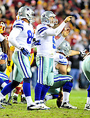 Dallas Cowboys quarterback Tony Romo (9), and center Ryan Cook (63) call signals in the fourth quarter against the Washington Redskins at FedEx Field in Landover, Maryland on Sunday, December 30, 2012.  Tight end James Hanna (84) is reading the signals from Romo.  The Redskins won the game 28 - 18 to capture the NFC East title.  .Credit: Ron Sachs / CNP.(RESTRICTION: NO New York or New Jersey Newspapers or newspapers within a 75 mile radius of New York City)