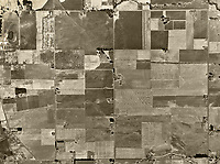 historical aerial photograph of the vicinity of the future Petaluma Municipal Airport (O69), Petaluma, Sonoma County, California, 1952.  East Washington Street is at the top of the photograph, Adobe Road at the right. The Petaluma Sky Ranch Airport is visible at the top slightly left of center and the Petaluma Fairgrounds are located on the top left.