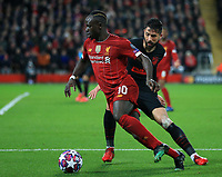 11th March 2020; Anfield, Liverpool, Merseyside, England; UEFA Champions League, Liverpool versus Atletico Madrid;  Sadio Mane of Liverpool takes on Thomas Partey of Atletico Madrid
