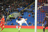 Cardiff City Stadium, Friday 11th Oct 2013. Nikolce Noveski of Macedonia attempts a back kick during the Wales v Macedonia FIFA World Cup 2014 Qualifier match at Cardiff City Stadium, Cardiff, Friday 11th Oct 2014. All images are the copyright of Jeff Thomas Photography-07837 386244-www.jaypics.photoshelter.com