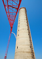 The ABB Group is a leading engineering company that helps customers use electrical power effectively, productively and sustainably. ABB is headquartered in Zurich, Switzerland, with operations around the globe. Photos are of the high-voltage transmission Cable Factory Tower under construction in Huntersville, NC. The transmission tower is located near ABB's 240,000-square-foot operations planned to be built in Huntersville's Commerce Station Business Park
