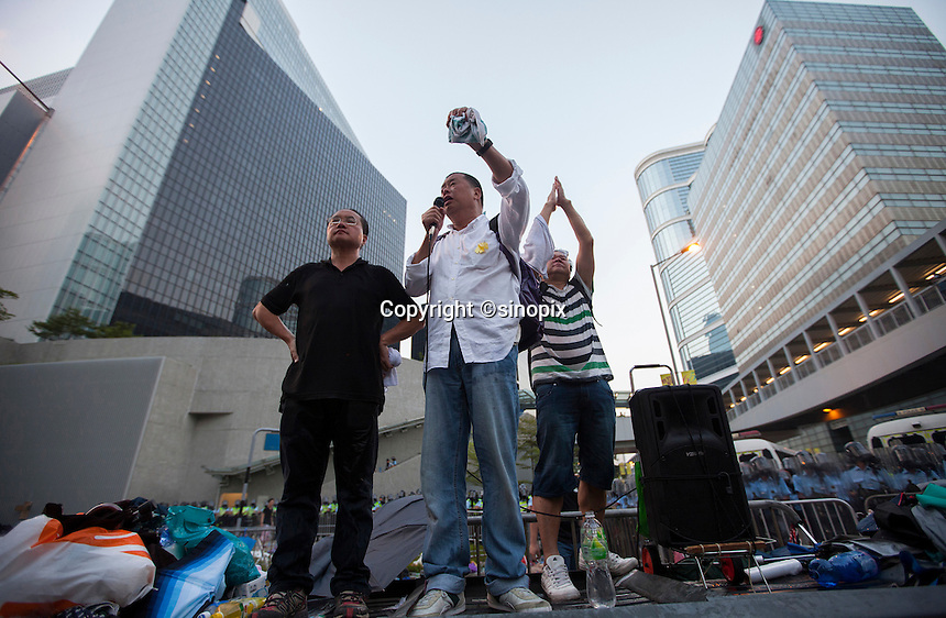 Hong Kong media tycoon Jimmy Lai (C) makes a speech in front of the Hong Kong government headquarters as Hong Kong police fire tear gas at pro-democracy protesters during the first day of the mass civil disobedience campaign Occupy Central, Hong Kong, China, 28 September 2014.