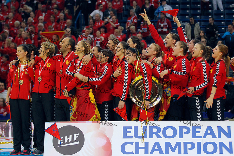 BELGRADE, SERBIA - DECEMBER 16: Montenegro handball team listen national anthem during the Women's European Handball Championship 2012 medal ceremony at Arena Hall on December 16, 2012 in Belgrade, Serbia. (Photo by Srdjan Stevanovic/Getty Images)