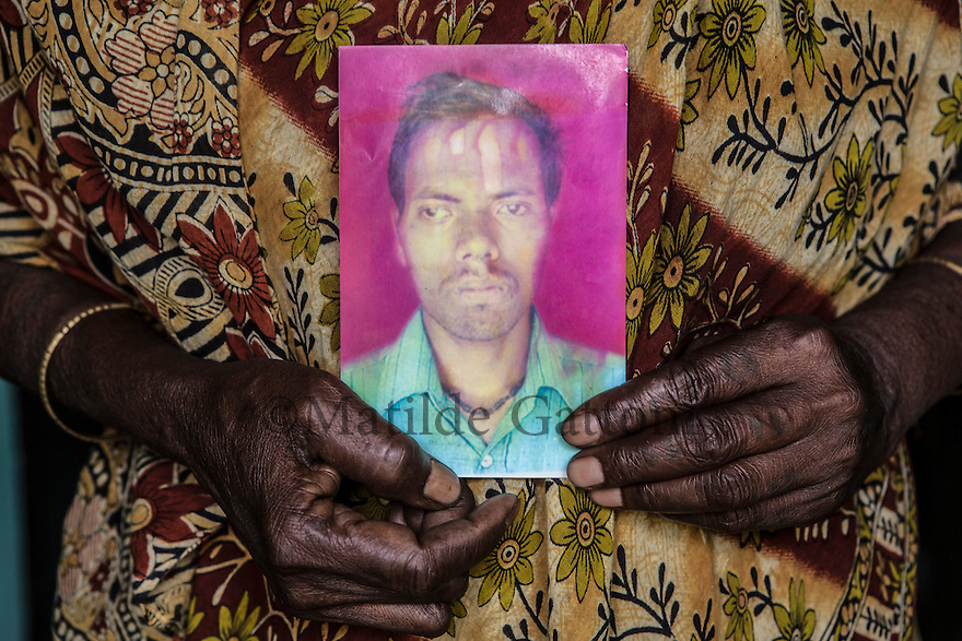 India – West Bengal: A photo of Krisha Ahir, 30, a former tea garden worker at Red Bank Tea Estate, in the Dooars region. Five years ago, when the tea garden was closed, Ahir decided to emigrate in order to support his one-year-old son and his aging parents. He was supposed to go to the state of Haryana to work in a poultry farm, but soon after he reached there he disappeared. His parents haven't had any news of him for the past four years.