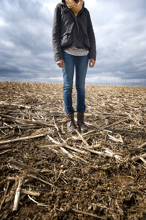 Portrait of the body of a 16 year old girl in a cornfield