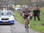 The chasing pelethon pass including Stefan Van Dijk (Accent Jobs-Wanty) over the cobbled climb of Eikenberg near Maarkedal during the 56th edition of the E3 Harelbeke, Belgium, 22nd  March 2013 (Photo by Eoin Clarke 2013)