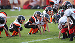 The Douglas Tiny Mites White play the Sparks Cardinals on opening night of Pop Warner competition in Gardnerville, Nev., on Friday, Sept. 9, 2011. .Photo by Cathleen Allison
