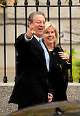 Washington, DC - November 26, 2007 -- Former United States Vice President Al Gore points to reporters as he and his wife, Tipper, walk along West Executive Avenue after his meeting in the Oval Office with United States President George W. Bush on Monday, November 26, 2007.  Gore was at the White House as one of the Nobel Prize honorees who met with the President..Credit: Ron Sachs / CNP.[RESTRICTION: No New York Metro or other Newspapers within a 75 mile radius of New York City]