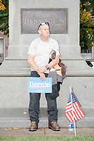 Sanders supporter Jim Bingham, of Stamford, Conn., leans against a statue after watching Democratic presidential candidate and Vermont senator Bernie Sanders speak at a small rally outside the NH State House after he filed the required paperwork and paid the $1000 filing fee to be on the 2020 Democratic presidential ballot in the NH Secretary of State's Office in Concord, New Hampshire, on Thu., October 31, 2019. As part of the filing process, Sanders signed a ceremonial primary ballot that is signed by all candidates in the race. Bingham says that the speech made him cry.