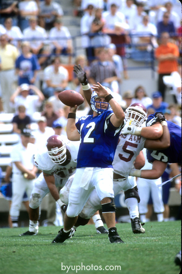 FTB 9608 382 TEXAS A&amp;M<br /> <br /> Pigskin Classic- BYU vs Texas A&amp;M. 12 Steve Sarkisian Quarterback.<br /> <br /> August 24, 1996<br /> <br /> Box Number: in office<br /> <br /> Photo by: Mark Philbrick/BYU<br /> <br /> Copyright BYU PHOTO 2008<br /> All Rights Reserved<br /> 801-422-7322<br /> photo@byu.edu