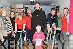 TURBO-THON: Sheila O'Sullivan with the help of Kenmare Triathlon Club organised a turbo-thon to raise funds for the Irish Pilgrimage Trust and she is pictured here with Fionán O'Sullivan starting off the 24-hour cycle last weekend in Kenmare Ice-cream shop.