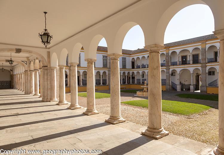 Cloisters collonade marble columns historic courtyard Evora University, Evora, Alto Alentejo, Portugal, Southern Europe