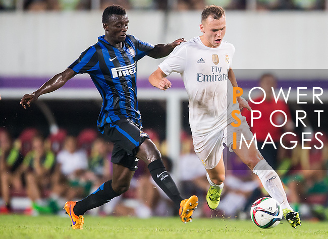 (R) Denis Cheryshev of Real Madrid CF being followed by (L) Assane Demoya Gnoukouri of FC Internazionale Milano during the FC Internazionale Milano vs Real Madrid  as part of the International Champions Cup 2015 at the Tianhe Sports Centre on 27 July 2015 in Guangzhou, China. Photo by Aitor Alcalde / Power Sport Images