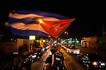 Photographs By Andrew Kaufman--Miami, Florida. August 1st, 2006. In Miami's Little Havana  on Calle Ocho, Cuban exiles rejoice in hapiness after hearing that Fidel Castro the communist dictator of Cuba had to cede power of Cuba to his brother Raul because of a very  difficult surgery on his intestine. The Cuban exiles in Miami are thrilled at the prospect that Fidel might die. They want a free Cuba. They chanted Libertad and Viva Cuba all night long and listened to Salsa songs from Cuba. This is the first time since Fidel took power in 1957 that he has ceded power.