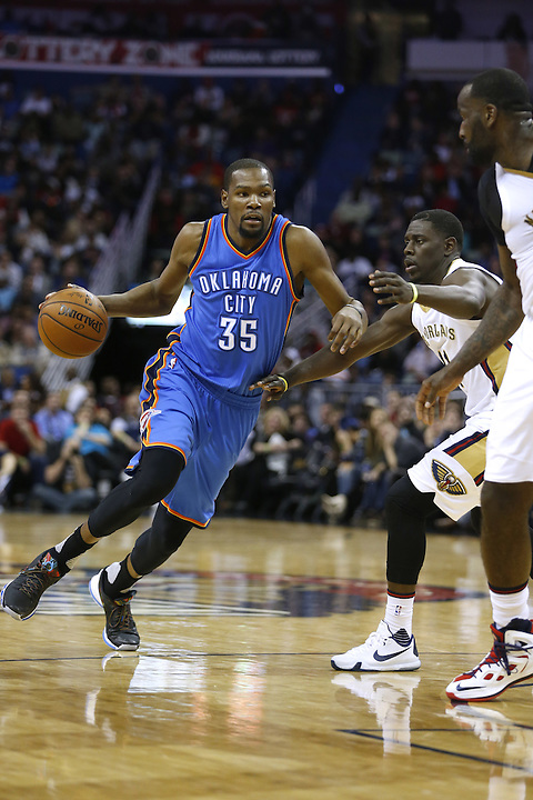 Oklahoma City Thunder forward Kevin Durant (35) drives against New Orleans Pelicans guard Jrue Holiday (11) during the second half of an NBA basketball game Thursday, Feb. 25, 2016, in New Orleans. The Pelicans won 123-119. (AP Photo/Jonathan Bachman)
