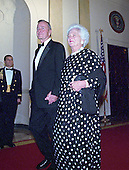 Former United States President George H.W. Bush and former first lady Barbara Bush hold hands as they walk into the 200th Anniversary of the White House Dinner in Washington, D.C. on November 9, 2000. <br /> Credit: Ron Sachs / CNP